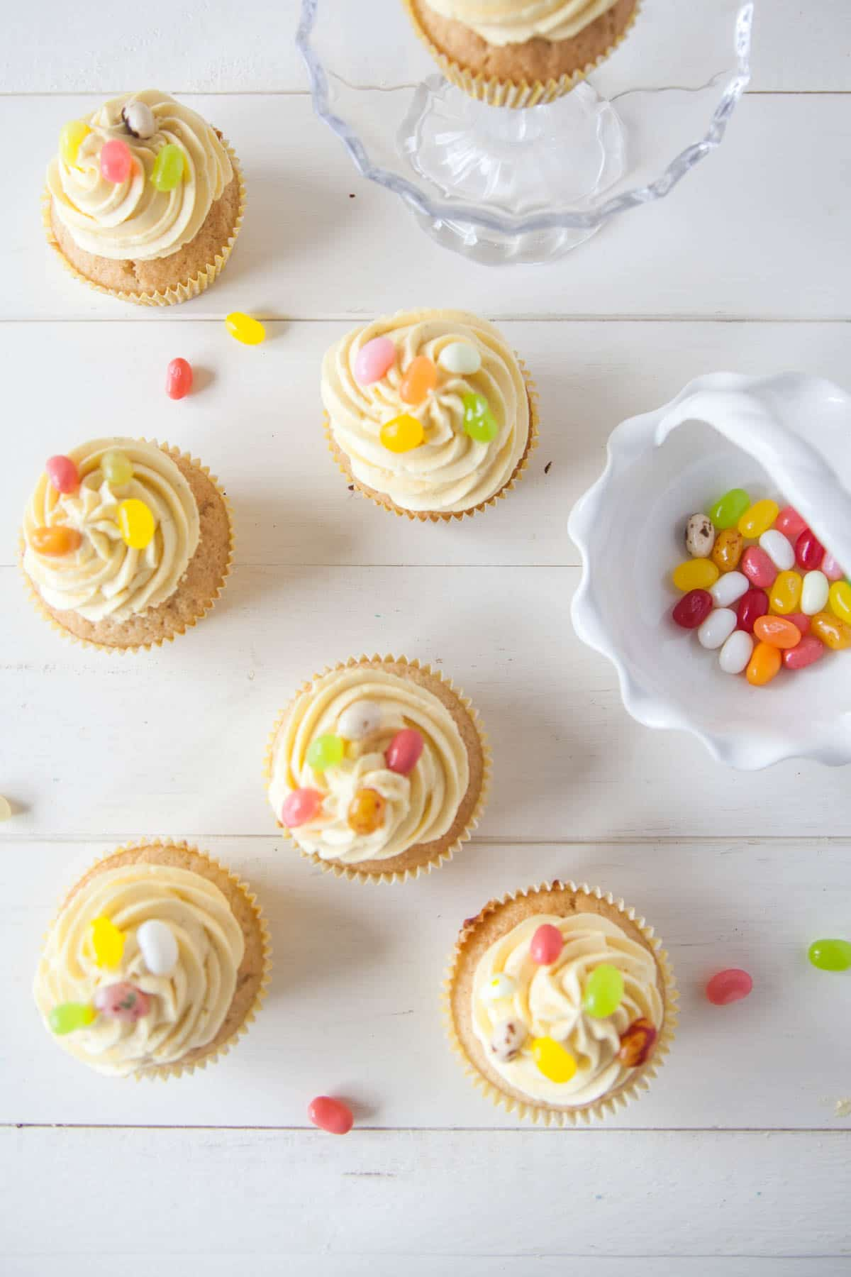 Vegan Lemon Cupcakes for Easter - Light, fluffy lemon cupcakes topped with dairy-free zesty buttercream and jelly beans!